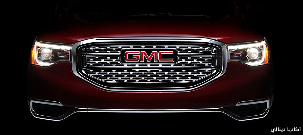 Distinctive Denali grille and iconic GMC headlights on a GMC Acadia Denali Luxury SUV.